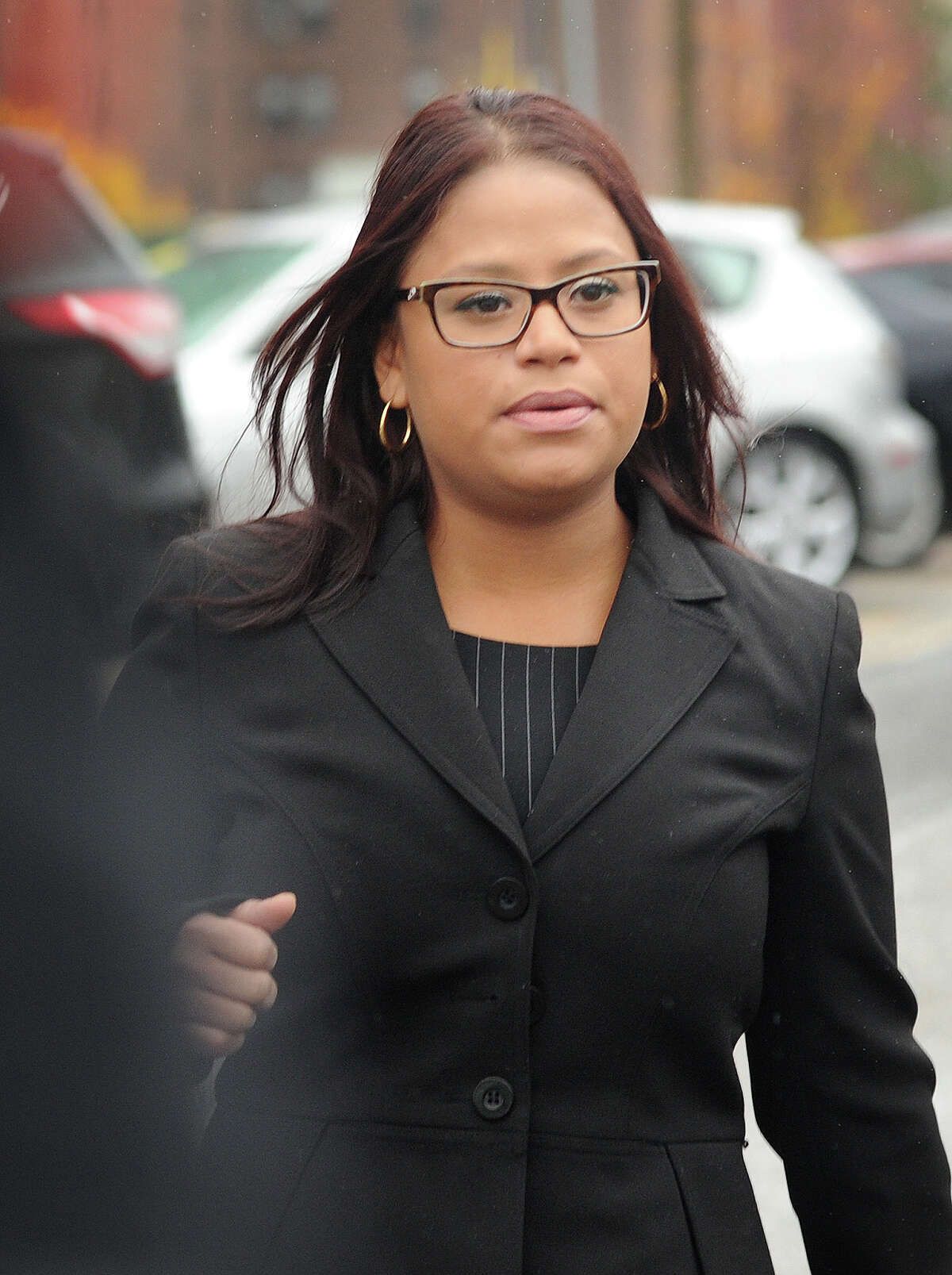 State Rep. Christina Ayala, D-Bridgeport, exits Superior Court in Bridgeport, Conn. on Thursday, November 6, 2014. Ayala, facing multiple charges of voting fraud, had her case continued to December 9.
