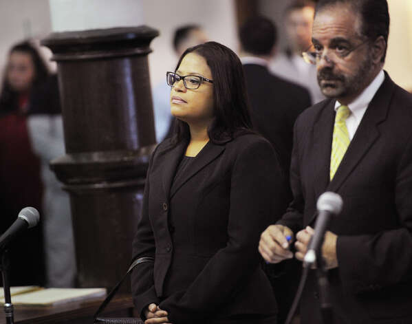State Rep. Christina Ayala, D-Bridgeport, stands with her lawyer, Guy Soares, at Superior Court in Bridgeport, Conn. on Thursday, Nove