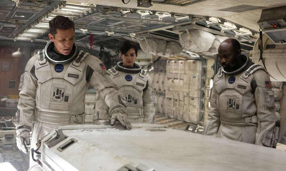 "Matthew McConaughey (left) is a space pilot looking for a new home for the dying Earth's people, in ""Interstellar,"" with Anne Hathaway and David Gyasi. Photo: Melinda Sue Gordon / Melinda Sue Gordon / Paramount Pictures / Handout"