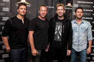 WEST HOLLYWOOD, CA - NOVEMBER 05:  (L-R) Daniel Adair, Chad Kroeger, Mike Kroeger and Ryan Peake of attend Nickelback Special Announcement And Live Performance at House of Blues Sunset Strip on November 5, 2014 in West Hollywood, California.  (Photo by Gabriel Olsen/FilmMagic)
