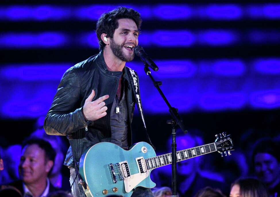 Thomas Rhett performs on stage at the 48th annual CMA Awards at the Bridgestone Arena on Wednesday, Nov. 5, 2014, in Nashville, Tenn. (Photo by Wade Payne/Invision/AP) ORG XMIT: TNBR303