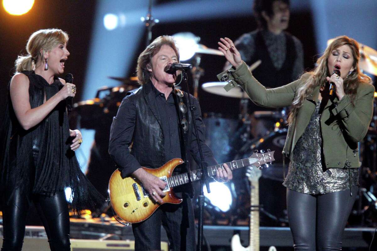 Jennifer Nettles, from left, Tom Johnston, of the musical group The Doobie Brothers, and Hillary Scott, of the musical group Lady Antebellum, perform onstage at the 48th annual CMA Awards at the Bridgestone Arena on Wednesday, Nov. 5, 2014, in Nashville, Tenn. (Photo by Wade Payne/Invision/AP) ORG XMIT: TNBR310