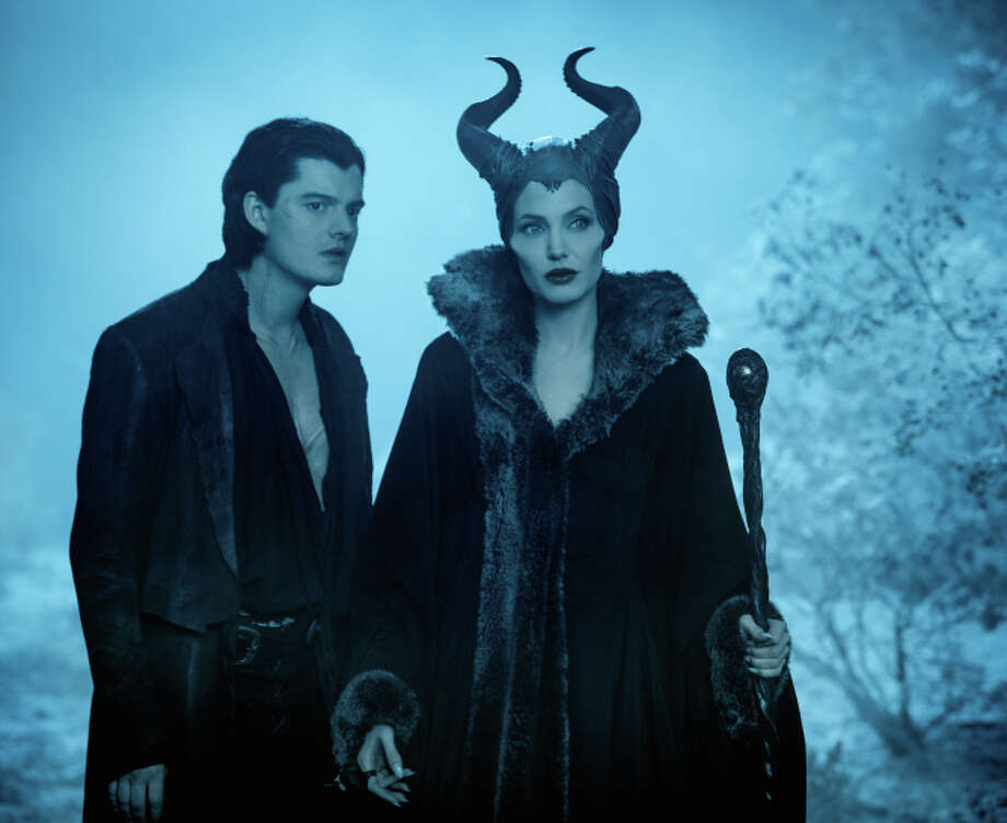 "Diaval (Sam Riley) and Maleficent (Angelina Jolie) in ""Maleficent,"" the Disney retelling of Sleeping Beauty from the viewpoint of the wicked fairy. Photo: Frank Connor / Frank Connor / Walt Disney Pictures / ONLINE_CHECK"