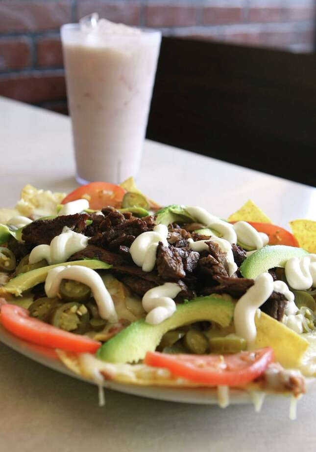 Beef nachos and horchata at Taqueria Datapoint. Photo: HELEN L. MONTOYA, File Photo / SAN ANTONIO EXPRESS-NEWS