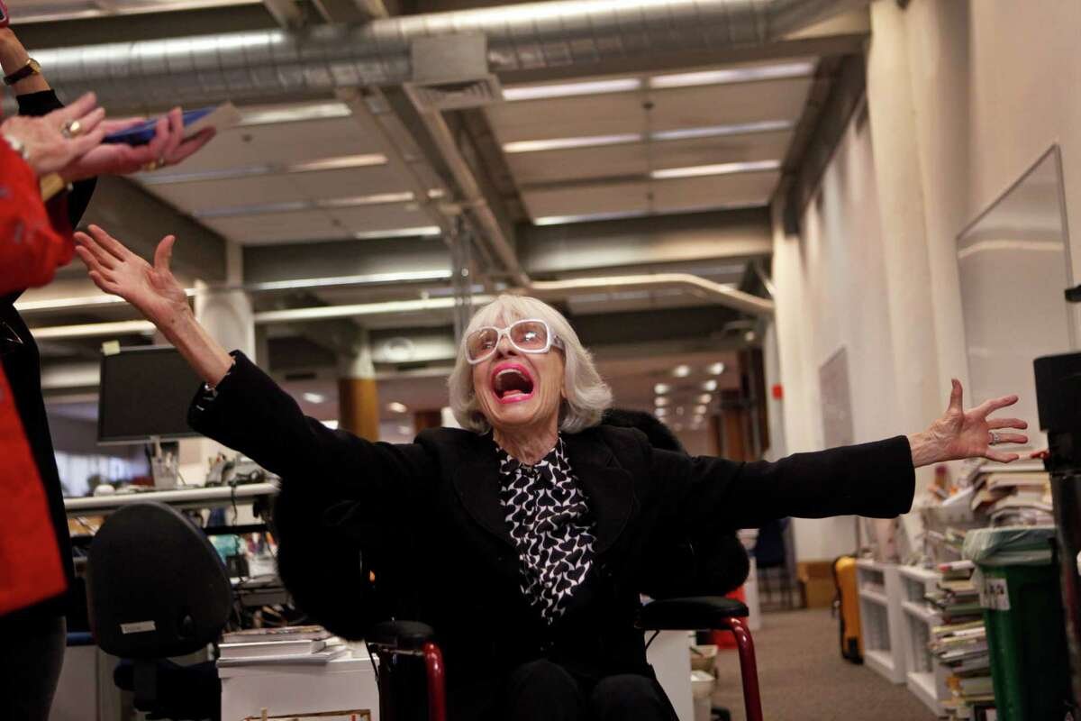 """Carol Channing breaks into a rendition of """"Before the Parade Passes By"""" during a visit to The Chronicle. The gracious singer had asked to visit the newsroom."""
