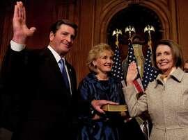 House Speaker Nancy Pelosi administers the House oath to Rep. John Garamendi in November 2009. Garamendi's wife, Patti, holds the Bible at center.