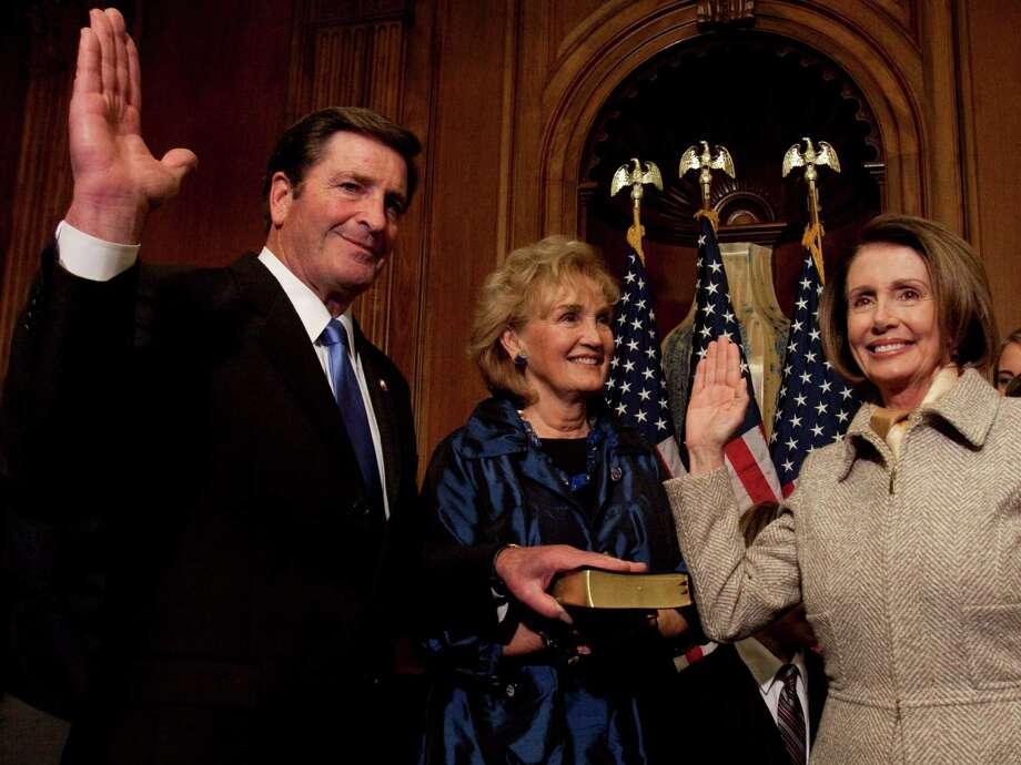 House Speaker Nancy Pelosi administers the House oath to Rep. John Garamendi in November 2009. Garamendi's wife, Patti, holds the Bible at center. Photo: Harry Hamburg / Harry Hamburg / AP / FR170004 AP