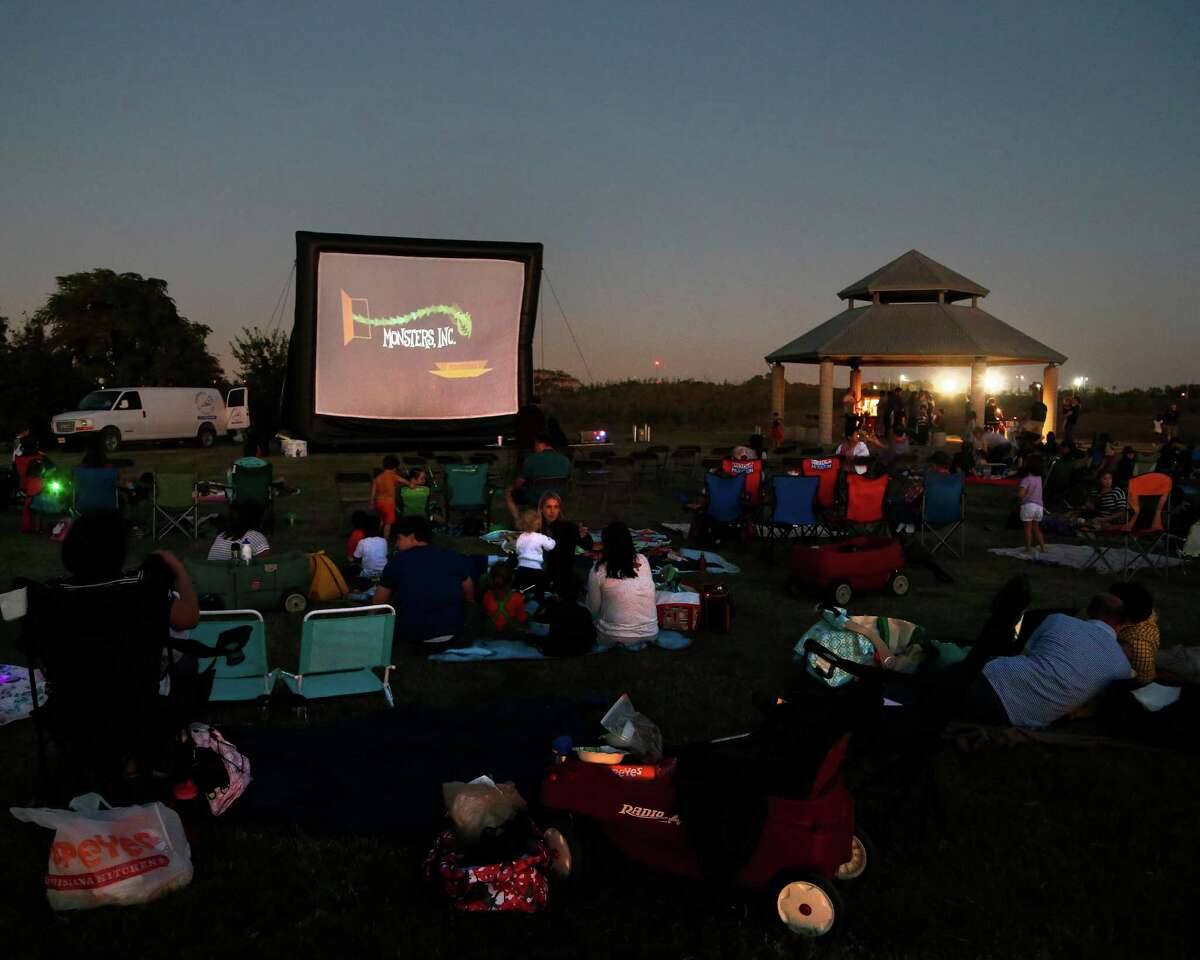 Families on the grass during movie night at Willow Waterhole Greenway, Saturday, Oct. 25, 2014, in Houston, which is located at 5300 Dryad Drive. ( Karen Warren / Houston Chronicle )
