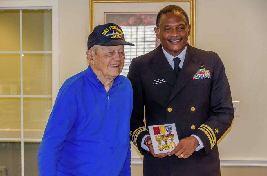 William Speer Jr., 95, receives a new set of Navy medals from Lt. Cmdr. Kenneth Minnard at the Gardens of Bellaire in October. Speer died Nov. 2. Photo: --