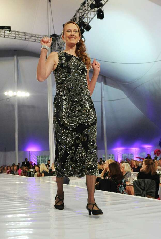 "Breast cancer survivor Loretta Walsh, of Rockland, N.Y., models a fall fashion from Richards of Greenwich at the ""Branching Out, Coming Together, Aspiring to a Cure"" fashion show benefiting the Breast Cancer Alliance at the Hyatt Regency in Greenwich, Conn. Thursday, Nov. 6, 2014.  The runway show featured the Brunello Cucinelli Fall 2014 collection and Spring 2015 collection preview, as well as a Survivors Celebration Show presenting autumn fashions from Richards of Greenwich modeled by breast cancer survivors.  Mike Greenberg, co-host of ESPN sports talk show ""Mike and Mike in the Morning,"" was the show's benefit speaker, telling the story of family friend Heidi Armitage who lost her battle with breast cancer in 2009. Photo: Tyler Sizemore / Greenwich Time"