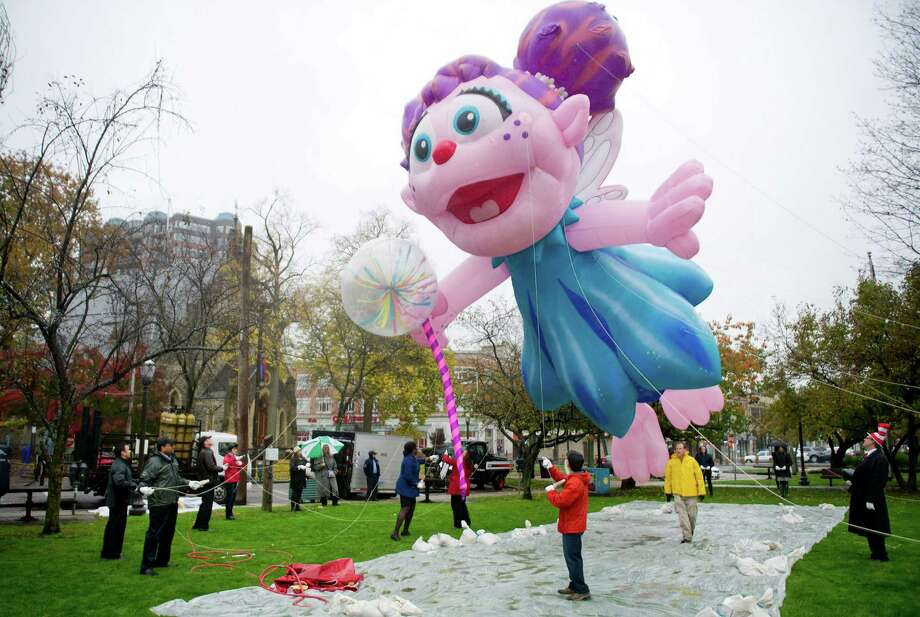 Volunteers practice handling a balloon of Sesame Street character Abby Cadabby on Thursday, November 6, 2014, at Latham Park in Stamford, Conn. The balloons are the centerpiece of the UBS Parade Spectacular on Sunday, November 23. The parade will begin at Summer and Hoyt Streets and continue down Atlantic Street. The balloons will be inflated during the Giant Balloon Inflation Party on Saturday, November 22, 3-6 p.m., at the intersection of Summer and Hoyt Streets in preparation for the parade, which begins at that intersection Sunday, November 23, at noon. Photo: Lindsay Perry / Stamford Advocate