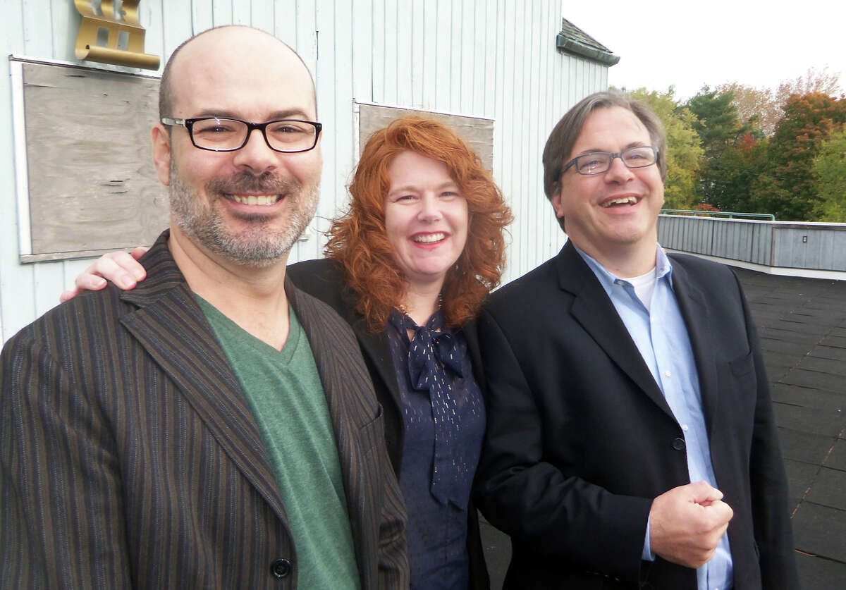 Bob Kennedy, Suzanne Cahill and Frank Farricker stand at the long-shuttered American Shakespeare Festival Theatre in Stratford. Their group, the Elm Street Theatre Company, is seeking approval from the Town Council to restore and operate the theater.