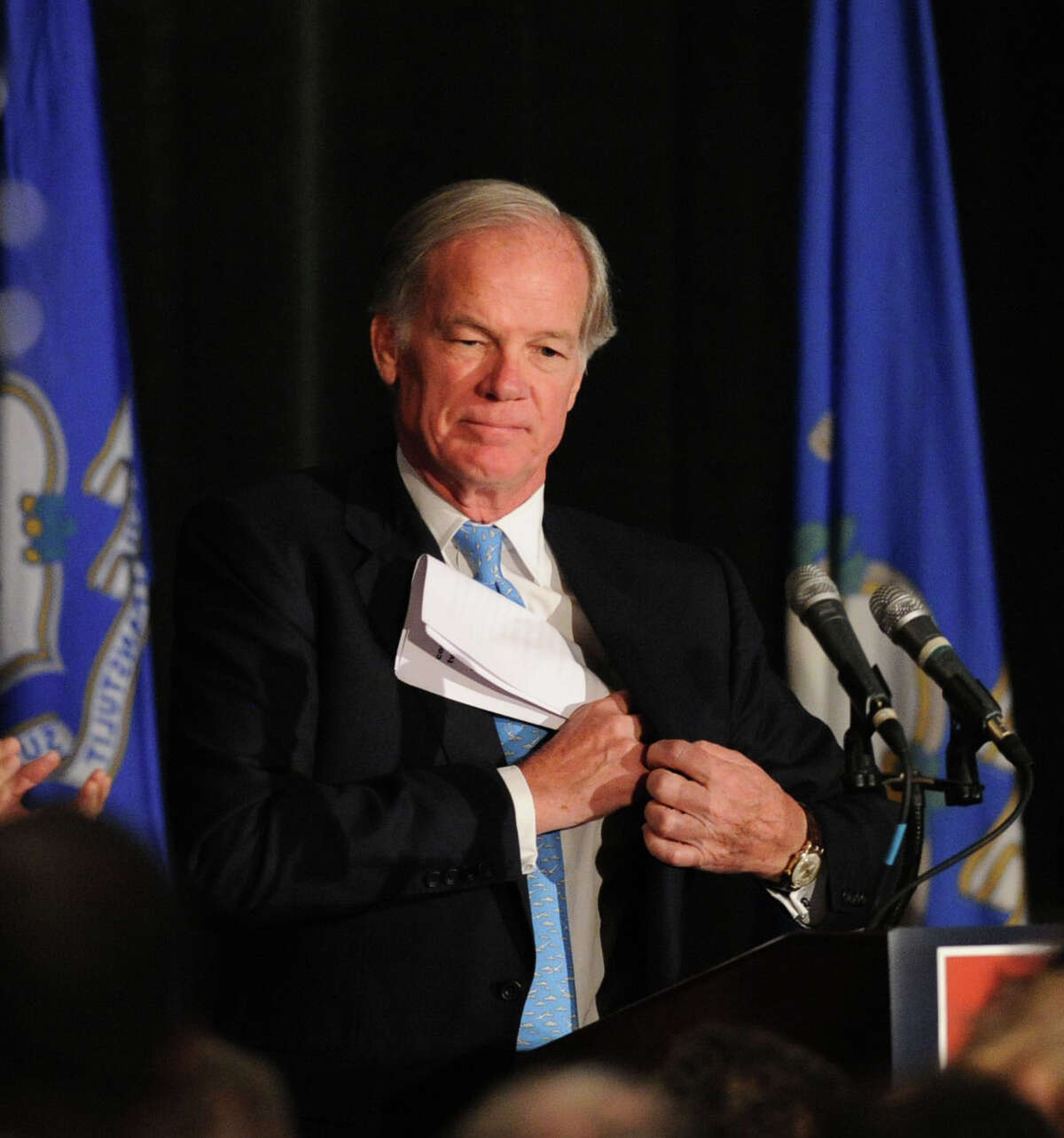 Republican candidate for Governor, Tom Foley, puts his speech back into his jacket pocket after speaking to supporters on election night at the Hyatt Regency Greenwich, Conn., Wednesday, Nov. 5, 2014.