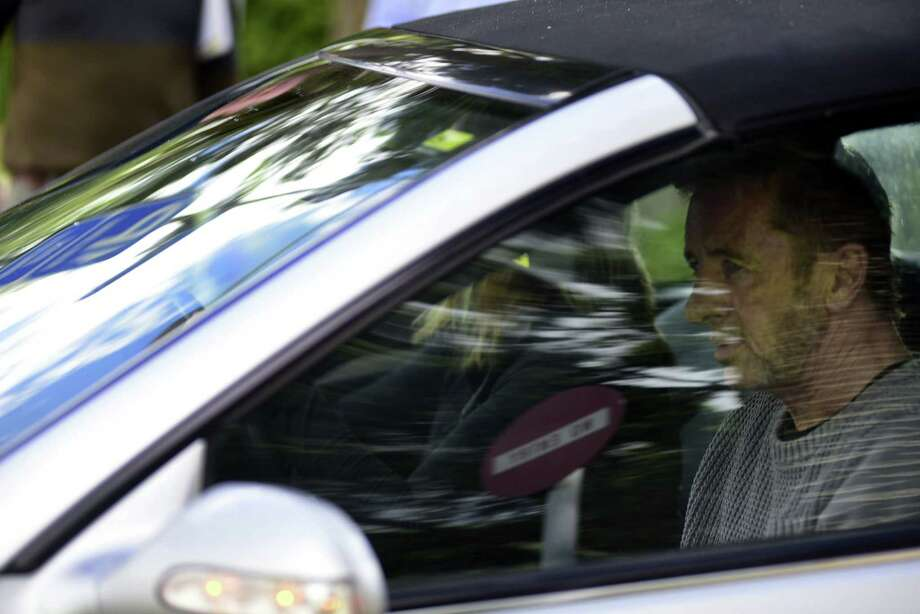 This picture taken on November 6, 2014 and provided by The New Zealand Herald shows the drummer with legendary rock band AC/DC, Phil Rudd, leaving the court house in Tauranga, New Zealand.  Phil Rudd was accused of trying to hire a hitman to kill two men after police raided his luxury New Zealand home.    AFP PHOTO / The New Zealand Herald / George Novak   NEW ZEALAND OUT  ---  AUSTRALIA OUTGEORGE NOVAK/AFP/Getty Images Photo: GEORGE NOVAK / AFP/Getty Images / AFP