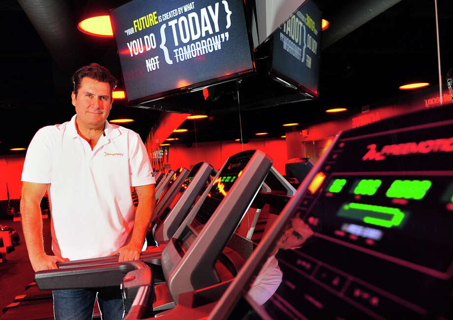 Mark Molina, owner of Orangetheory Fitness, poses inside the new franchise at the Tunxis Hill Shopping Center in Fairfield, Conn., on Thursday Nov. 6, 2014. The franchise store, based in Florida, is the first one in Connecticut with two more planned for Milford and Bridgeport. Photo: Christian Abraham / Connecticut Post