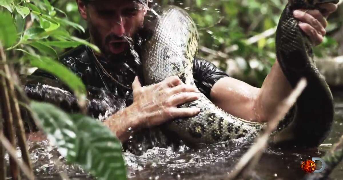 """Paul Rosolie, a filmmaker and naturalist, built a custom snake-proof suit so he could be devoured by an anaconda for a Discovery Channel television special. A YouTube promo for the Dec. 7 special - titled, predictably, """"Eaten Alive"""" - shows Rosolie stalking an anaconda, otherwise minding its own business, before it presumably attacks and eats him."""