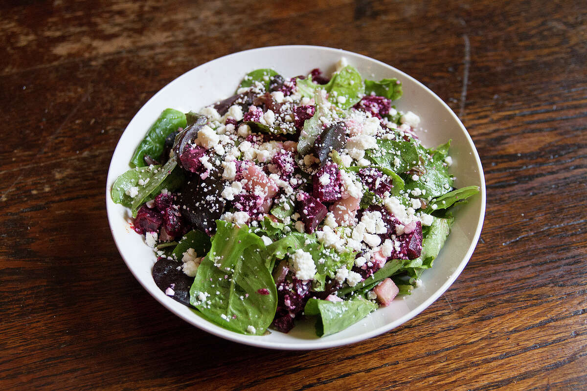 Beet salad includes with queso fresco, poached apples and a pecan vinagrette.