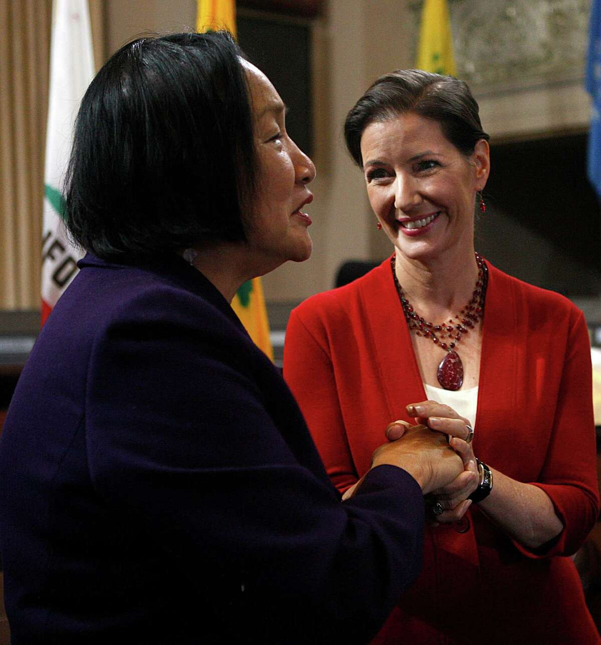 Mayor Jean Quan (left) and mayor-elect Libby Schaaf (right) talk about the upcoming period of transition at a press conference in the city council chambers at city hall in Oakland, Calif., on Thursday, November 6, 2014.