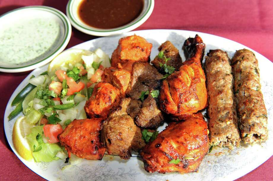 The Kabab Platter has chicken tikka, seekh kabob, bihari kabob and tandoori chicken on Wednesday, Nov. 5, 2014, at Kabab Masala in Halfmoon, N.Y. (Cindy Schultz / Times Union) Photo: Cindy Schultz / 00029354A