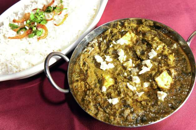 Palak Paneer is spinach with homemade cheese and served with rice on Wednesday, Nov. 5, 2014, at Kabab Masala in Halfmoon, N.Y. (Cindy Schultz / Times Union) Photo: Cindy Schultz / 00029354A