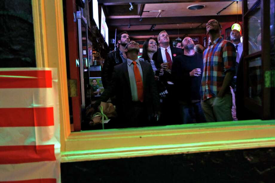 Proposition E campaign manager Todd David (third from right) joins others watching voting results at Valley Tavern on 24th Street in San Francisco on Nov. 4, 2014. Photo: Scott Strazzante / The Chronicle / ONLINE_YES