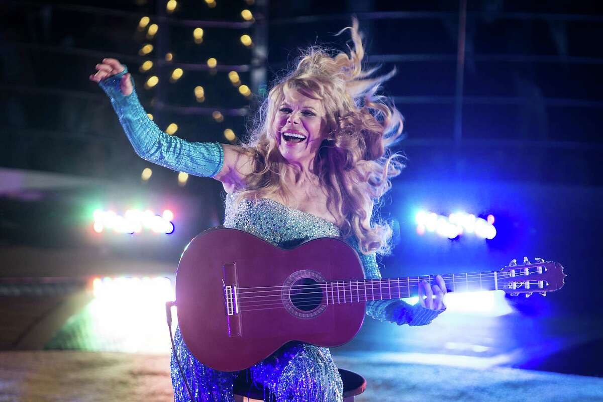 Performer Charo entertains the crowd aboard the Regal Princess at Port Everglades in Fort Lauderdale, Fla. on Wednesday, Nov. 5, 2014 for its North American debut and naming ceremony.