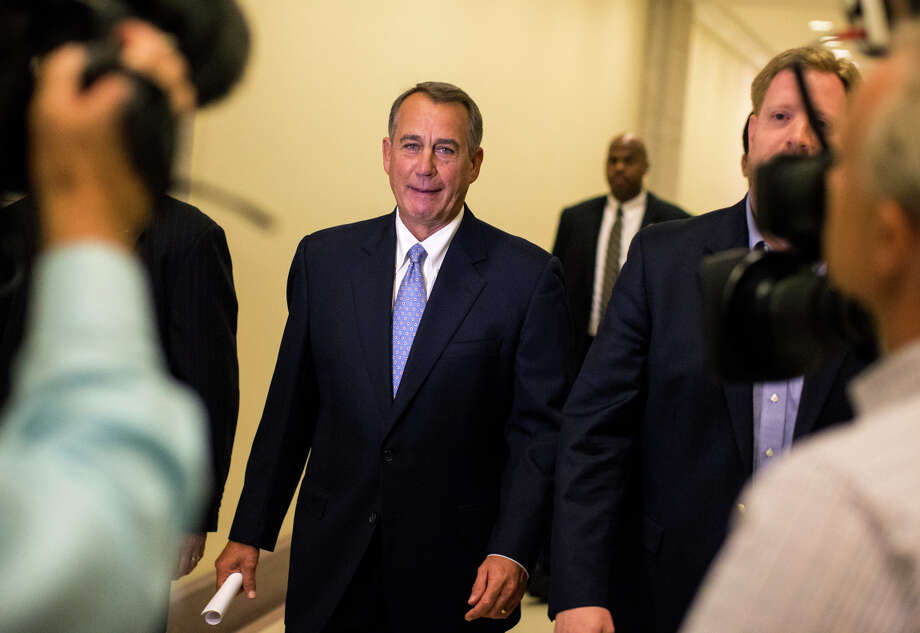House Speaker John Boehner, whose GOP forces were bolstered in Tuesday's elections, urges President Obama not act unilaterally on immigration reform. Photo: JABIN BOTSFORD / New York Times / NYTNS