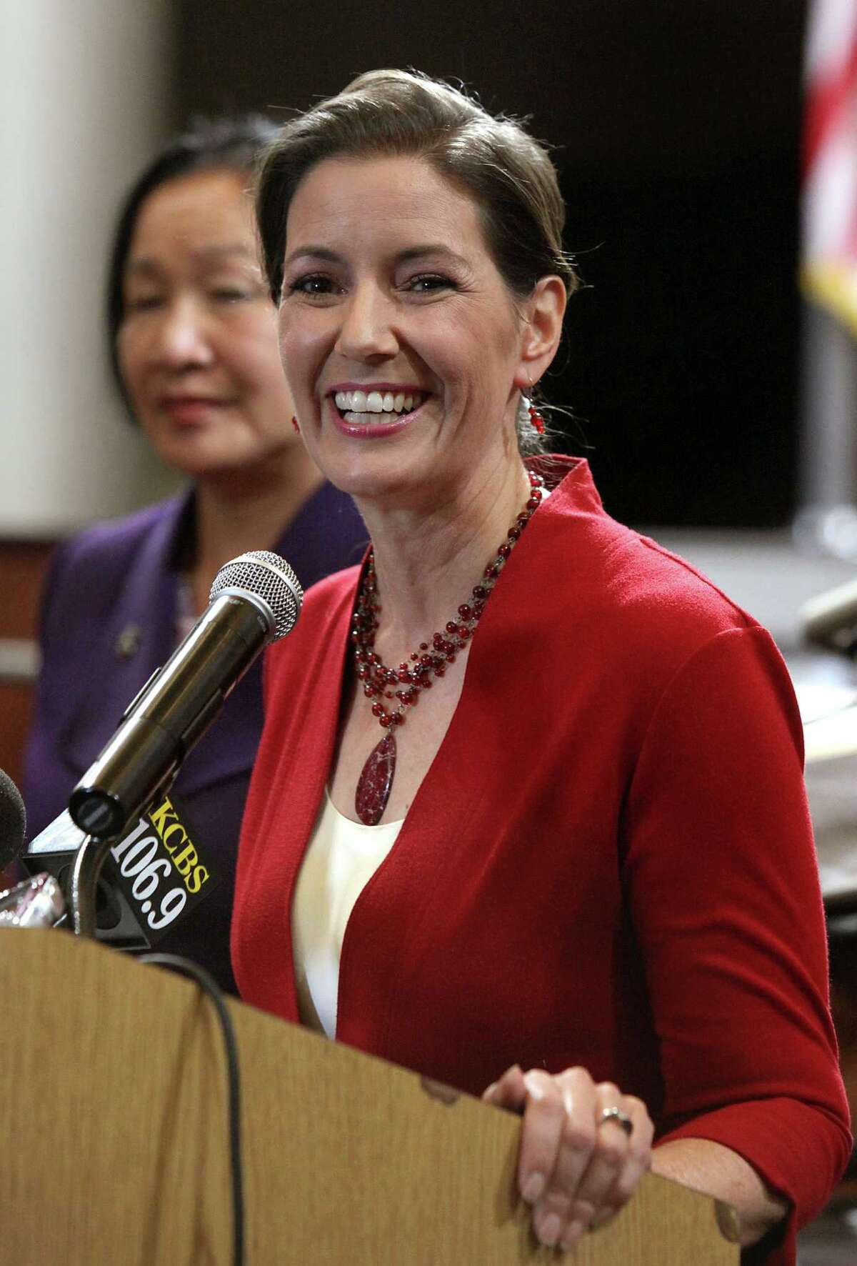 Oakland mayor-elect Libby Schaaf (front) and mayor Jean Quan (back) talk about the upcoming period of transition at a press conference in the city council chambers at city hall in Oakland, Calif., on Thursday, November 6, 2014.