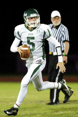 Shen's quarterback Ryan Van Galen looks for an open man during their football game against CBA on Friday, Sept. 19, 2014, at Christian Brothers Academy in Colonie, N.Y. (Cindy Schultz / Times Union) Photo: Cindy Schultz / 00028643A