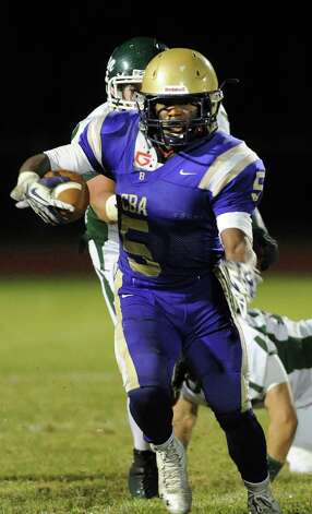 CBA's Jakil Paul fights off the Shen defense during their football game on Friday, Sept. 19, 2014, at Christian Brothers Academy in Colonie, N.Y. (Cindy Schultz / Times Union) Photo: Cindy Schultz / 00028643A