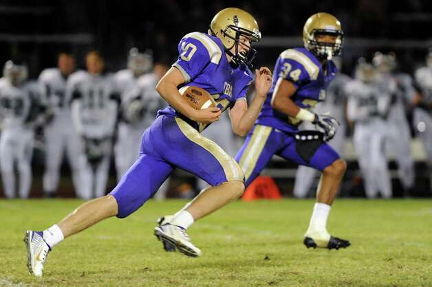 CBA's Donald Vivian, left, takes off down the field during their football game against Shen on Friday, Sept. 19, 2014, at Christian Brothers Academy in Colonie, N.Y. (Cindy Schultz / Times Union) Photo: Cindy Schultz / 00028643A