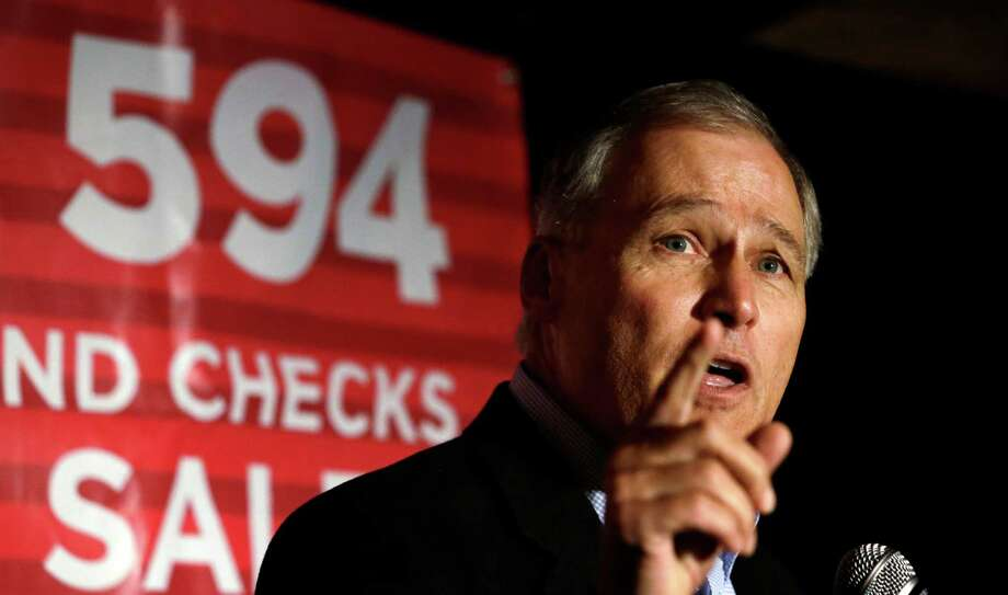 Washington Gov. Jay Inslee addresses an election night party for Initiative 594, a measure seeking universal background checks on gun sales and transfers, which passed. The NRA says it will fight the measure. Photo: Elaine Thompson, STF / AP