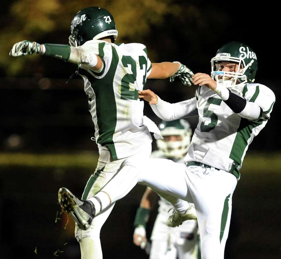 Shen's quarterback Ryan Van Galen, right, and Jordan Zlogar celebrate their win over CBA after their football game on Friday, Sept. 19, 2014, at Christian Brothers Academy in Colonie, N.Y. (Cindy Schultz / Times Union) Photo: Cindy Schultz / 00028643A