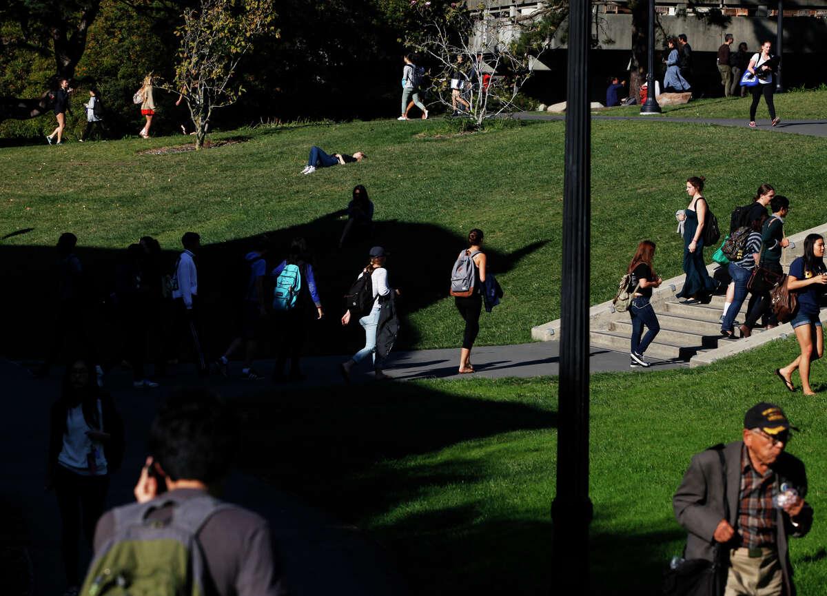 Students cross a grassy area near Chan Shun Auditorium at UC Berkeley on Nov. 6, 2014.