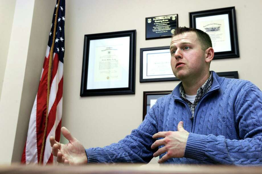 Matthew T. Kuchta, Veterans Affairs Coordinator for Western Connecticut State University, regularly works with businesses and local veterans to try and place then in area jobs. He speaks to a reporter Thursday, Nov. 6, 2014. Photo: Carol Kaliff / The News-Times