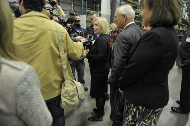 Senator Kirsten Gillibrand, center, and Congressman Paul Tonko talk to members of the media as they take a tour of Hill & Markes on Thursday, Nov. 6, 2014, in Amsterdam, N.Y.  (Paul Buckowski / Times Union) Photo: Paul Buckowski / 00029380A