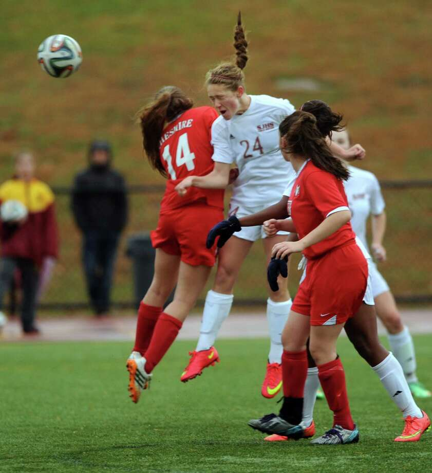 St. Joseph's Lindsey Savko and Cheshire's Jessica Goul go up for a header Thursday, Nov. 6, 2014, during their soccer match at St. Joseph High School in Trumbull, Conn. Photo: Autumn Driscoll / Connecticut Post