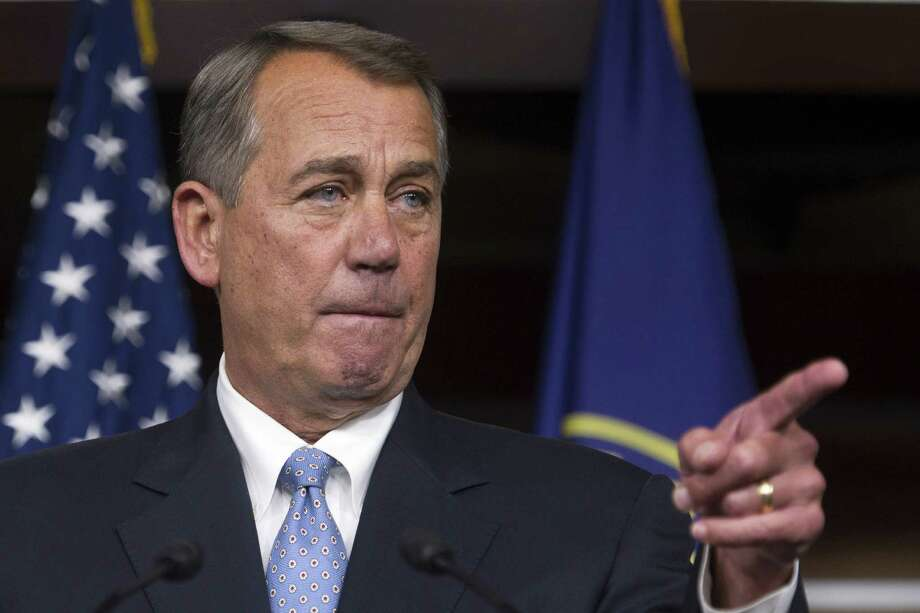 House Speaker John Boehner of Ohio gestures during a news conference on Capitol Hill in Washington, Thursday, Nov. 6, 2014. Boehner said the Republican-controlled Congress will act to approve the Keystone XL pipeline, make changes in the health care law and encourage businesses to hire more veterans. (AP Photo/Cliff Owen) Photo: Cliff Owen, FRE / FR170079 AP
