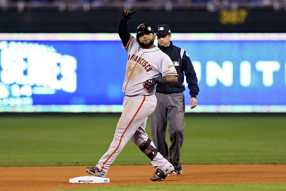 KANSAS CITY, MO - OCTOBER 29:  Pablo Sandoval #48 of the San Francisco Giants reacts against the Kansas City Royals during Game Seven of the 2014 World Series at Kauffman Stadium on October 29, 2014 in Kansas City, Missouri.  (Photo by Elsa/Getty Images) ORG XMIT: 519100543 Photo: Elsa / 2014 Getty Images