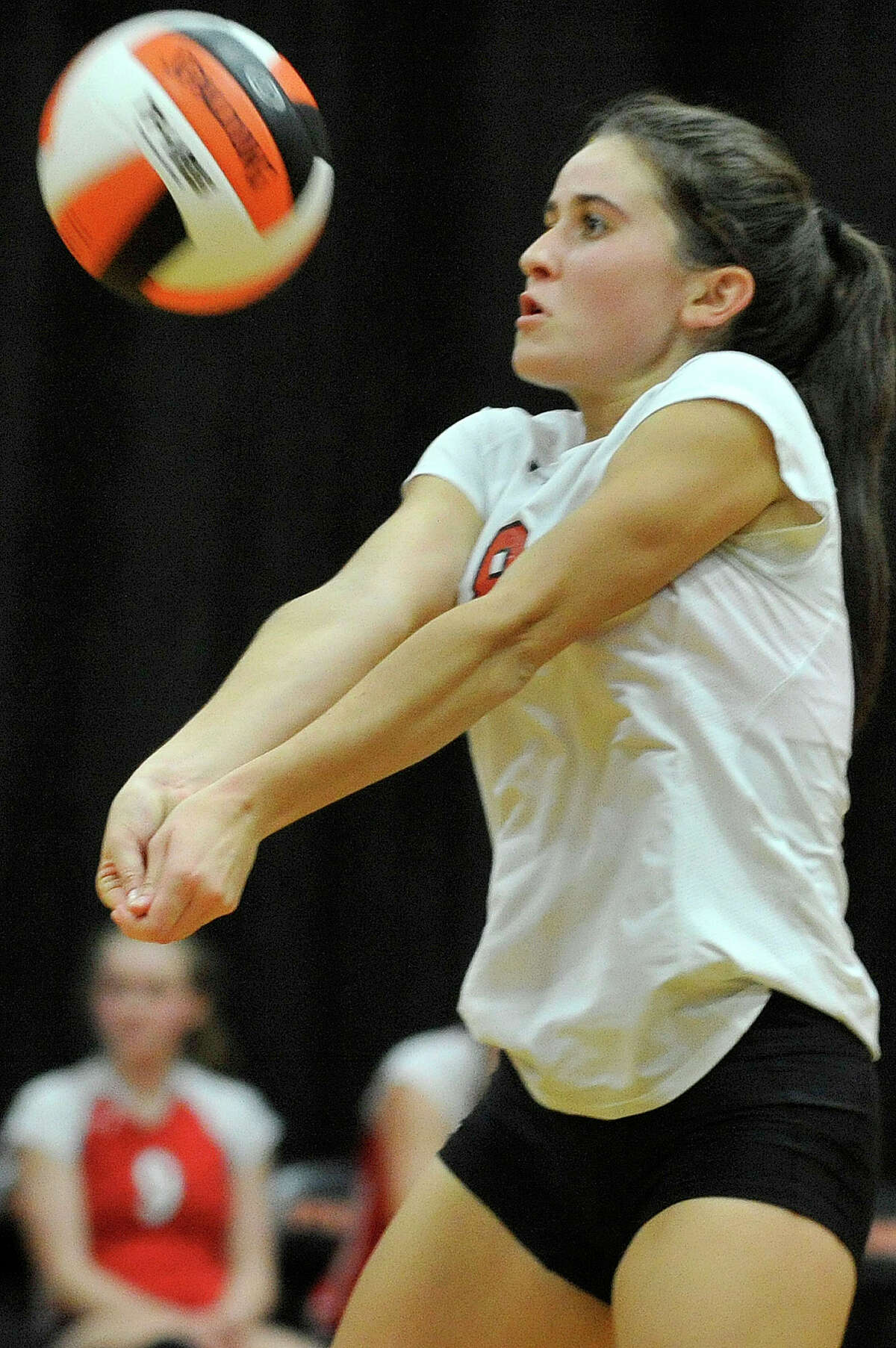 Greenwich's Micaela Lew keeps the ball alive during the Cardinals Class LL second round playoff volleyball match against Stamford at Stamford High School in Stamford, Conn., on Thursday, Nov. 6, 2014. Stamford won, 3-2.