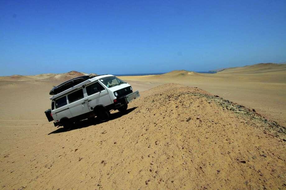 Nacho takes to the dunes in the Nazca Desert in Peru. Photo: Brad And Sheena Van Orden, Drive Nacho Drive / Drive Nacho Drive