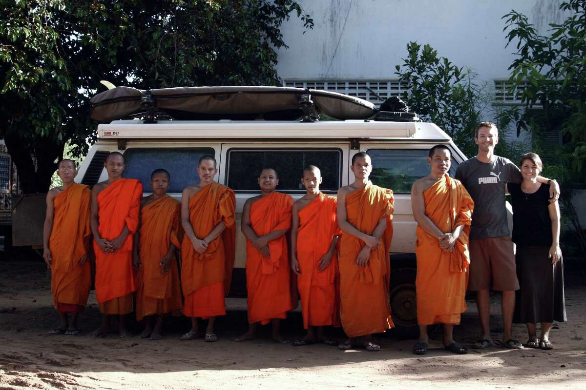 After being ejected from their countryside campground by local police, Brad and Sheena are taken in by a Buddhist monastery and allowed to camp next to the temple. Near Siem Reap, Cambodia.