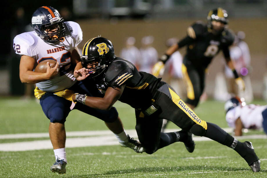 D.J. Allen (right) of Brennan brings down Brandeis running back Gavin Turney during the first half of their District 27-6A championship game at Farris Stadium on Thursday, Nov 6, 2014.  MARVIN PFEIFFER/ mpfeiffer@express-news.net Photo: Marvin Pfeiffer, San Antonio Express-News / Express-News 2014