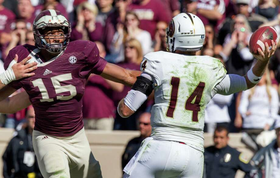 Texas A&M defensive lineman Myles Garrett, left, rarely has been denied in his pursuit of quarterbacks. The freshman has 11 sacks, 31/2 coming in his last game. Photo: Cody Duty, Staff / © 2014 Houston Chronicle