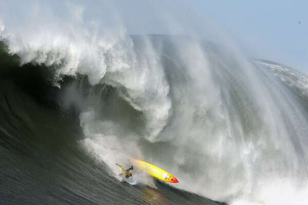 "Darryl ""Flea"" Virostko wipes out in the fifth heat of the Mavericks Surf Contest. Surfers from around the globe braved the 50-foot-high swells at Mavericks Surf Contest in Half Moon Bay, Calif., on Saturday, February 13, 2010. Chris Bertish of South Africa was selected the winner."