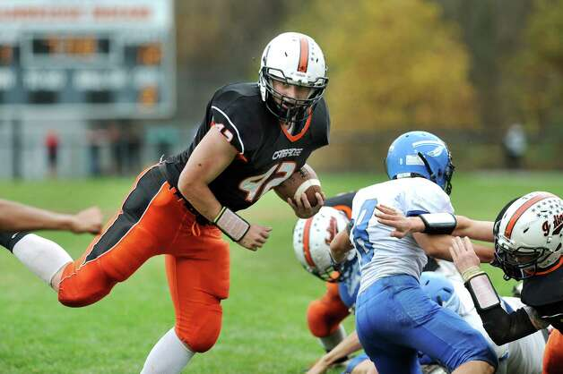 Cambridge's Chris Warnke, left, breaks loose from the pack as he makes his way to the end zone during their football game against Hoosic Valley on Saturday, Oct. 18, 2014, at Cambridge High in Cambridge, N.Y. (Cindy Schultz / Times Union) Photo: Cindy Schultz / 00029061A