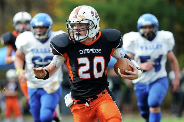 Cambridge's Caleb Rowland, center, carries the ball during their football game against Hoosic Valley on Saturday, Oct. 18, 2014, at Cambridge High in Cambridge, N.Y. (Cindy Schultz / Times Union) Photo: Cindy Schultz / 00029061A