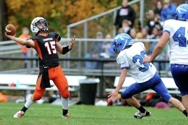 Cambridge's quarterback Ethan English, left, readies to pass during their football game against Hoosic Valley on Saturday, Oct. 18, 2014, at Cambridge High in Cambridge, N.Y. (Cindy Schultz / Times Union) Photo: Cindy Schultz / 00029061A