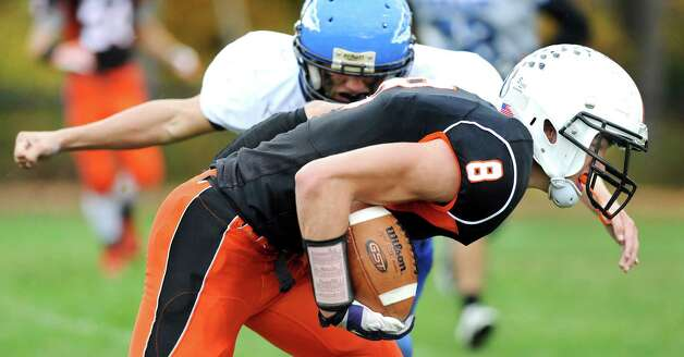 Cambridge's Josh Steele, right, charges forward when he hauls in a pass during their football game against Hoosic Valley on Saturday, Oct. 18, 2014, at Cambridge High in Cambridge, N.Y. (Cindy Schultz / Times Union) Photo: Cindy Schultz / 00029061A