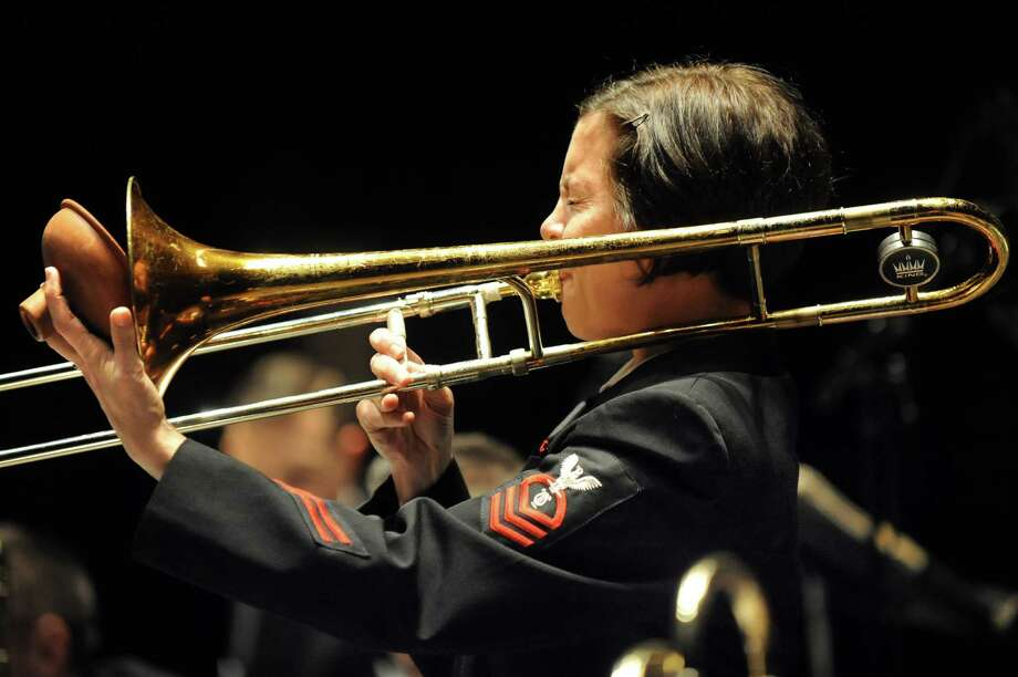 Chief Musician Jennifer Krupa of Hemet, Calif. plays a trombone solo during the U.S. Navy Commodores Jazz Ensemble performance on Thursday, Nov. 6, 2014, at the Palace Theatre in Albany, N.Y. (Cindy Schultz / Times Union) Photo: Cindy Schultz / 00029391A